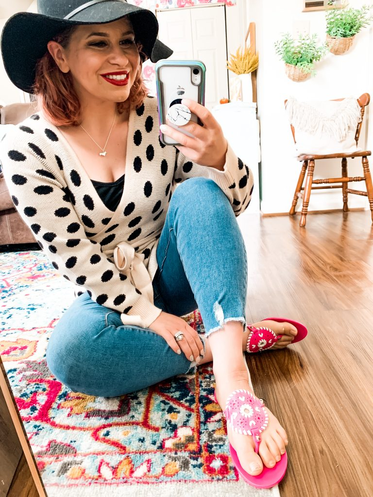 woman taking a selfie wearing jeans, polka dot top, and pink slippers for How to be a work from home mom