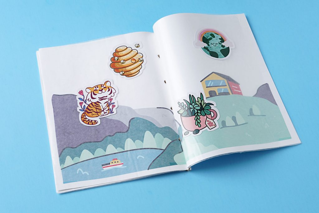 an open DIY sticker book for kids