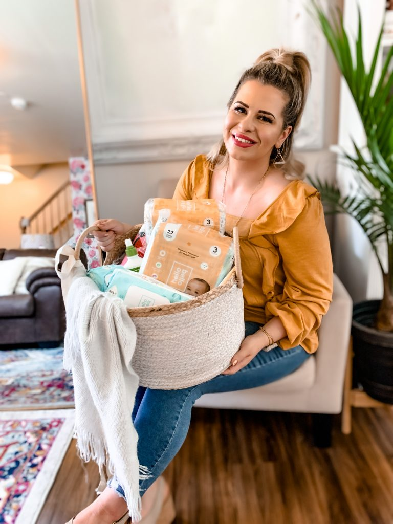 woman sitting down and holding a basket full of products