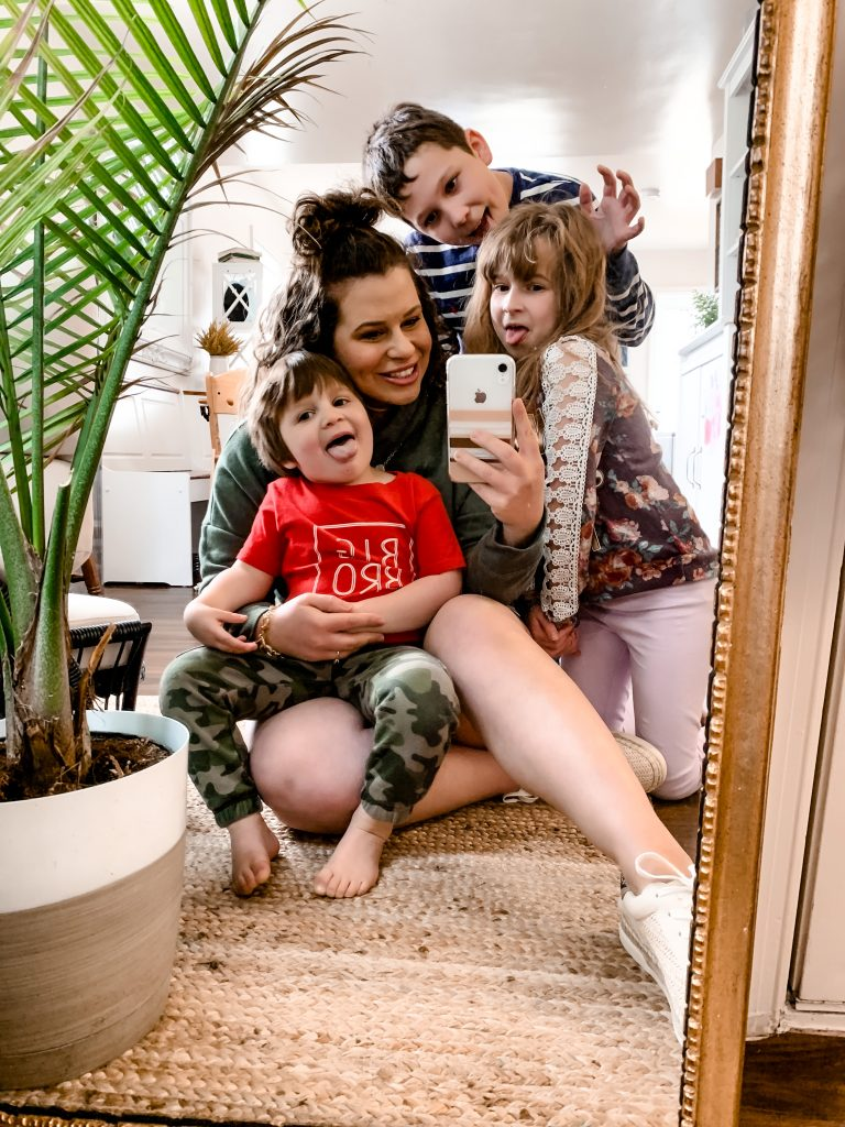 woman taking a selfie with her three kids for How to be a Work from Home Mom