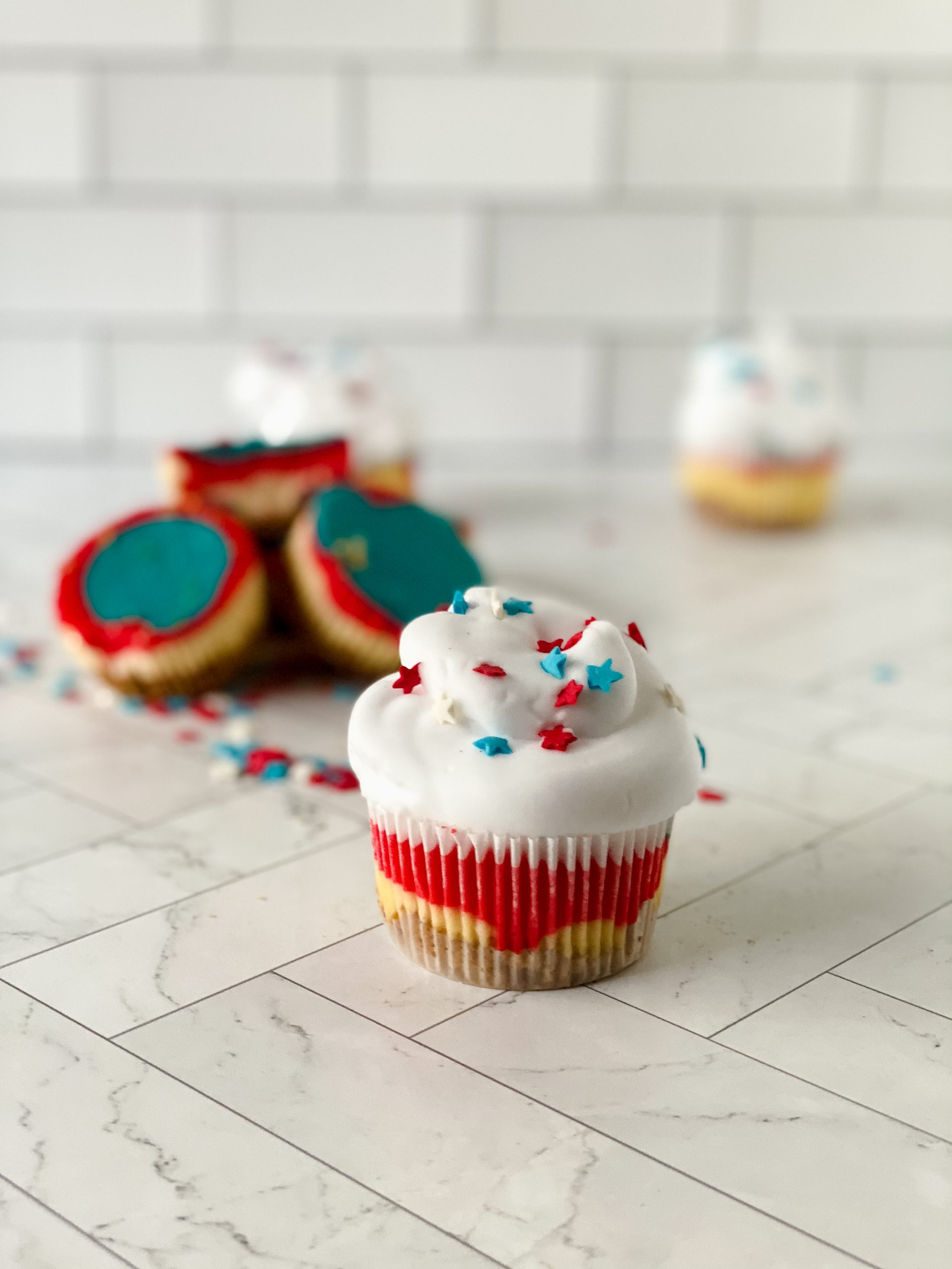 a dessert cupcake with stars toppings