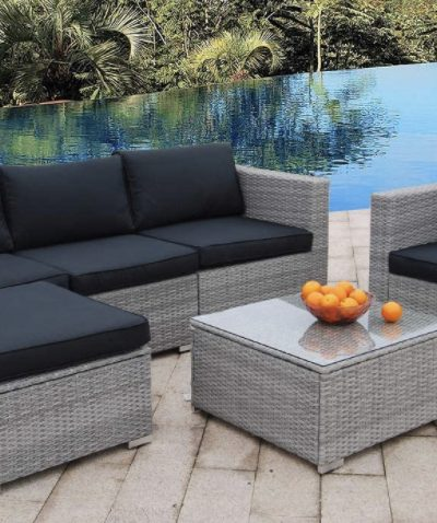 furniture on the poolside with oranges on the table